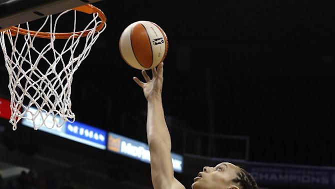 Phoenix Mercury's Brittney Griner scores her first basket in the first half during a WNBA basketball game against the Chicago Sky on Monday, May 27, 2013, in Phoenix. (AP Photo/Ross D. Franklin)
