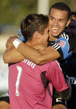 San Jose Earthquakes' Jason Hernandez, right, jumps into the arms of Earthquakes goalie David Bingham (1) after Bingham scored a goal against West Bromwich Albion during the first half of an international friendly soccer game Tuesday, July 12, 2011, in Santa Clara, Calif. (AP Photo/Ben Margot)