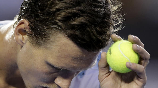 Tomas Berdych of the Czech Republic prepares to serve to Andy Murray of Britain  during their semifinal match at the Australian Open tennis championship in Melbourne, Australia, Thursday, Jan. 29, 2015. (AP Photo/Bernat Armangue)