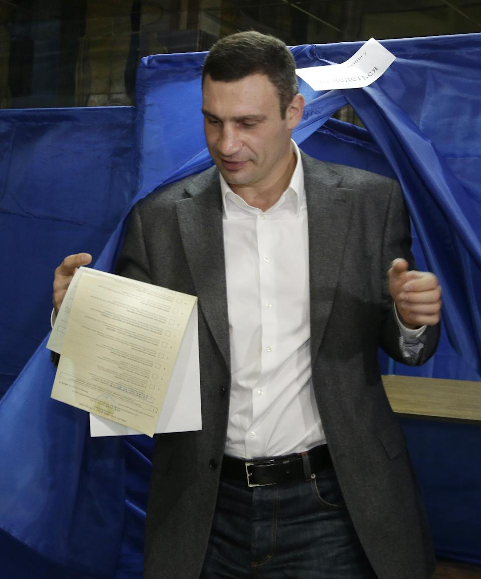 WBC Heavyweight Champion and Chairman of the Ukrainian democratic opposition Ukrainian Democratic Alliance for Reform Party Vitali Klitschko leaves a voting booth  at a polling station during parliamentary elections in Kiev, Ukraine, Sunday, Oct. 28, 2012. (AP Photo/Efrem Lukatsky)