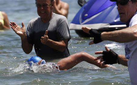 U.S. long-distance swimmer Diana Nyad completes her swim from Cuba as she arrives in Key West
