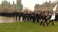 Police march on Parliament Hill just before the 35th annual memorial service for officers who have died while on duty.