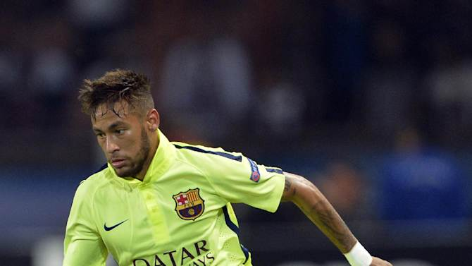 Barcelona's Brazilian forward Neymar controls the ball during a match on September 30, 2014 at the Parc des Princes stadium in Paris