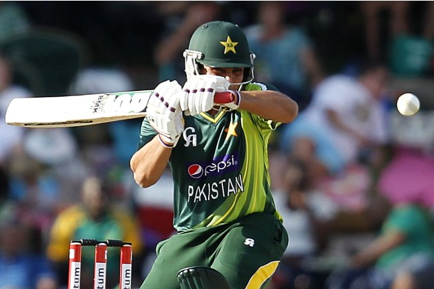 Pakistan's Kamran Akmal plays a shot before being caught out by South Africa's Graeme Smith during their one day international cricket match in Bloemfontein