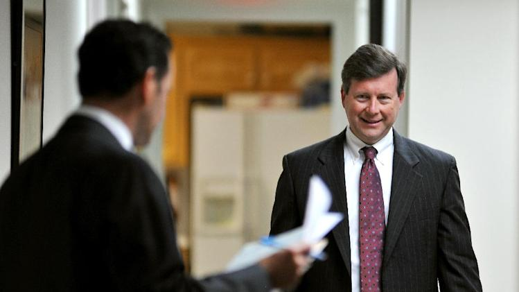 "Jacksonville, Fla.  attorney Kelly Mathis, right, greets his attorney Mitch Stone before an interview at Stone's office in Ponte Vedra Beach, Fla., Wednesday, March 20, 2013. Mathis is accused by prosecutors as the ""mastermind"" of the Allied Veterans of the World internet gambling operation. (AP Photo/Rick Wilson)"