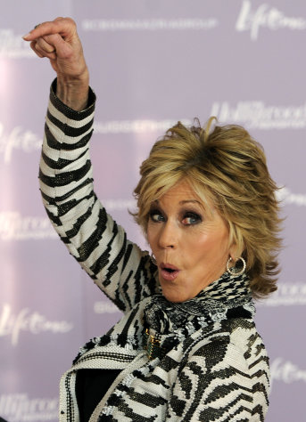 Actress Jane Fonda, recipient of the 2011 Sherry Lansing Leadership Award, gestures to Lansing on the red carpet at The Hollywood Reporter&#39;s 20th annual Women in Entertainment Breakfast in Beverly Hills, Calif., Wednesday, Dec. 7, 2011. The event celebrated the 100 most powerful women in the entertainment industry. (AP Photo/Chris Pizzello)