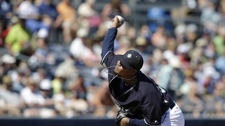 Seattle Mariners starting pitcher Felix Hernandez throws during an exhibition spring training baseball game against the Texas Rangers Sunday, March 9, 2014, in Peoria, Ariz. (AP Photo/Darron Cummings)