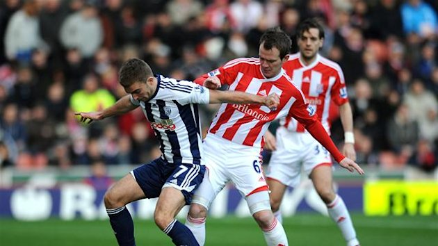 Stoke City's Glenn Whelan and West Bromwich Albion's James Morrison battle for the ball