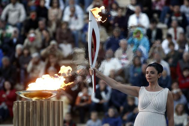 Greek actress Menegaki raises an Olympic torch for the Sochi 2014 Winter Games during a handover ceremony in Athens