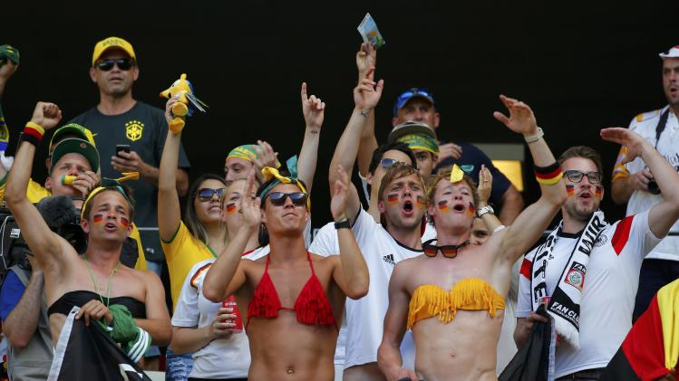 Fans of Germany cheer before their 2014 World Cup Group G soccer match against Ghana at the Castelao arena in Fortaleza
