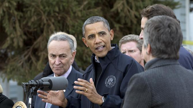 President Barack Obama gestures as he speaks during a news conference on Cedar Grove Avenue, a street significantly impacted by Superstorm Sandy, Thursday, Nov. 15,2012, on Staten Island, in New York. From left are, Sen. Charles Schumer, D-N.Y., the president, Housing and Urban Development Secretary Shaun Donovan, New York Gov. Andrew Cuomo and Homeland Security Secretary Janet Napolitano.  (AP Photo/Carolyn Kaster)