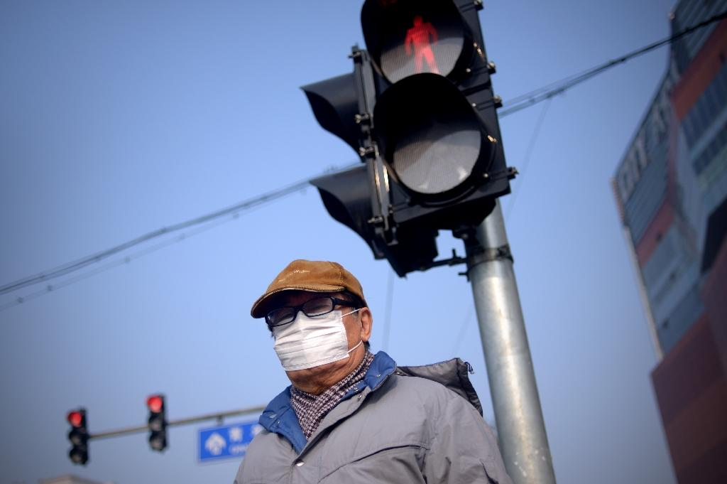 Beijing issues orange alert for heavy smog