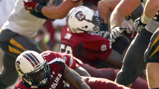 South Carolina running back Marcus Lattimore dives through a hole in the Missouri defensive line to score a touchdown during the first half of an NCAA college football game, at Williams-Brice Stadium in Columbia, S.C., Saturday, Sept. 22, 2012.  (AP Photo/Brett Flashnick)