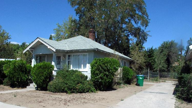The garage no longer sits behind this house on East Ninth Street in Reno, Nev., pictured Thursday, Aug. 21, 2014, on the edge of the University of Nevada campus where 19-year-old Michelle Mitchell's body was found in 1976. Cathy Woods, the woman who was convicted of her murder and has served more than 30 years in prison, is seeking a new trial based on new DNA evidence. (AP Reno/Scott Sonner)