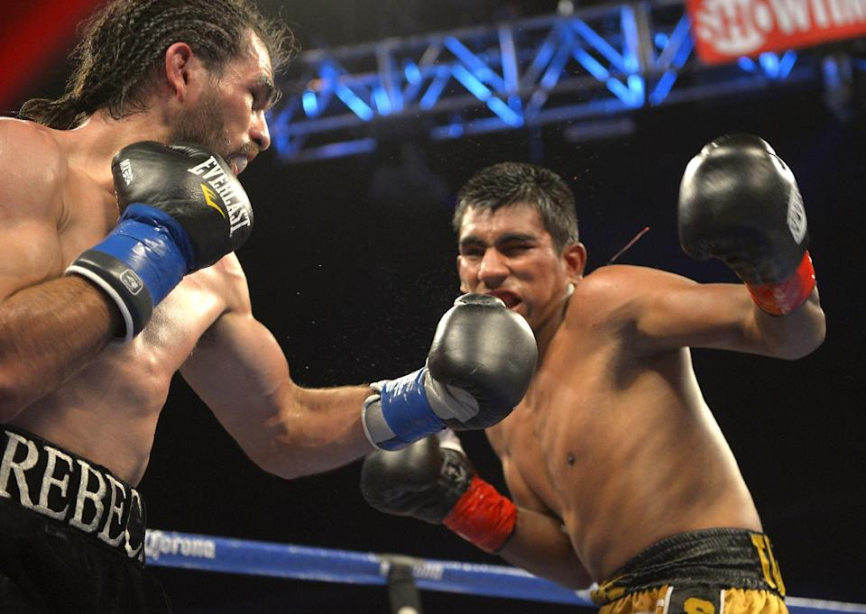 Alfredo Angulo, left, connects with Jorge Silva during their middleweight boxing bout, Saturday, Dec. 15, 2012, in Los Angeles. (AP Photo/Mark J. Terrill)