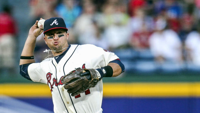 FILE - In this Sept. 2, 2012, file photo, Atlanta Braves infielder Martin Prado throws to first for an out during the eighth inning of a baseball game against the Philadelphia Phillies in Atlanta. A person familiar with the situation says the Arizona Diamondbacks has traded outfielder Justin Upton to the Braves in a deal that sends All-Star third baseman Martin Prado to the Diamondbacks.  The person spoke to The Associated Press on condition of anonymity on Thursday, Jan. 24, 2013, because the trade has not officially been announced. (AP Photo/Daniel Shirey, File)