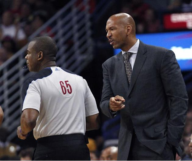 New Orleans Pelicans head coach Monty Williams challenges an official in the first half of an NBA basketball game against the Oklahoma City Thunder in New Orleans, Friday, Dec. 6, 2013