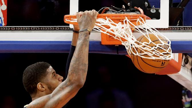 Indiana Pacers' Paul George dunks against the New York Knicks in the second half of Game 5 of an Eastern Conference semifinal in the NBA basketball playoffs, at Madison Square Garden in New York, Thursday, May 16, 2013. (AP Photo/Julio Cortez)