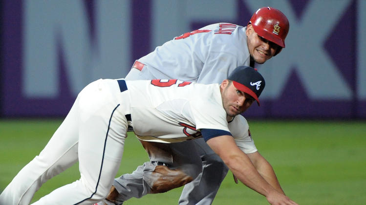 St. Louis Cardinals' Yadier Molina is forced out on the double play by Atlanta Braves second baseman Dan Uggla during the second inning of a baseball game at Turner Field, Sunday, July 28, 2013, in Atlanta. (AP Photo/David Tulis)