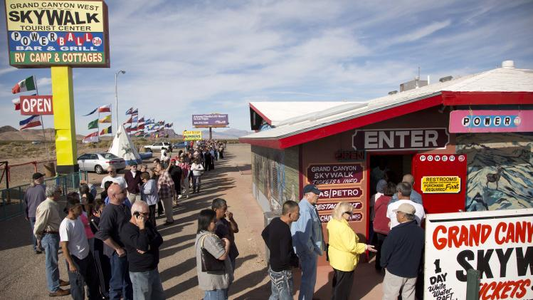 A crowd of people line up outside the Arizona Last Stop convenience store and souvenir shop to buy Powerball tickets, Tuesday, Nov. 27, 2012, in White Hills, Ariz. There has been no Powerball winner since Oct. 6, and the jackpot already has reached a record level for the game. Already over $500 million, it is the second-highest jackpot in lottery history, behind only the $656 million Mega Millions prize in March. (AP Photo/Julie Jacobson)