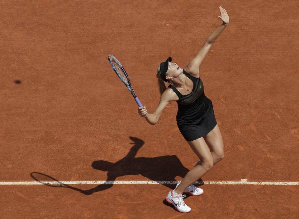 Maria Sharapova of Russia prepares to serve in her first round match against Alexandra Cadantu of Romania at the French Open tennis tournament in Roland Garros stadium in Paris, Tuesday May 29, 2012. Sharapova won in two sets 6-0, 6-0. (AP Photo/Michel Spingler)