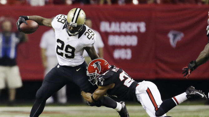 New Orleans Saints running back Chris Ivory (29) is stopped by Atlanta strong safety William Moore (25) during the first half of an NFL football game, Thursday, Nov. 29, 2012, in Atlanta. (AP Photo/David Goldman)