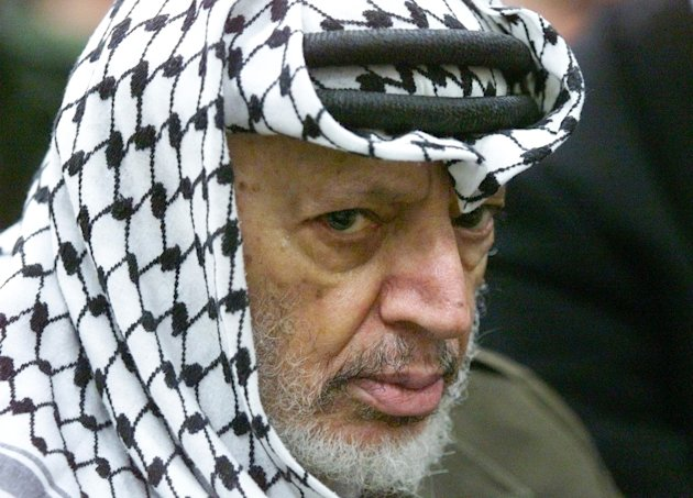 FILE - In this May 31, 2002 file photo photo Palestinian leader Yasser Arafat pauses during the weekly Muslim Friday prayers in his headquarters in the West Bank city of Ramallah. Yasser Arafat&#39;s body may be exhumed to allow for more testing of the causes of his death, the Palestinian president said Wednesday, July 4, 2012, after a Swiss lab said it found elevated levels of a radioactive isotope in belongings the Palestinian leader is said to have used in his final days. (AP Photo/Lefteris Pitarakis, File)