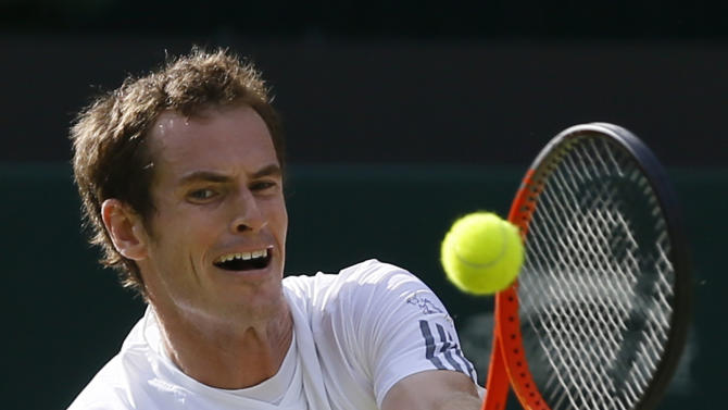 Andy Murray of Britain plays a return to Mikhail Youzhny of Russia during a Men's singles match at the All England Lawn Tennis Championships in Wimbledon, London, Monday, July 1, 2013. (AP Photo/Kirsty Wigglesworth)