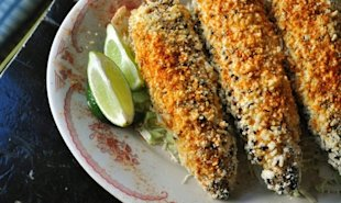In Mexico, they serve elotes callejeros on the street: grilled corn slathered with mayonnaise, cotija cheese, and lime juice.