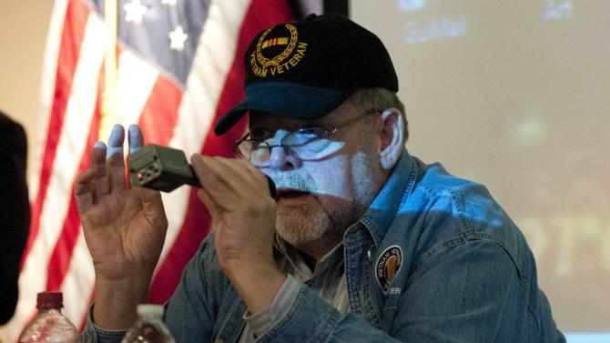 U.S. Air Force veteran Jack McManus provides background and history on the development and use of herbicides that came to form Agent Orange during a town hall meeting in Portland