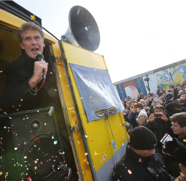 American actor and singer Hasselhoff addresses demonstration along open air section of Berlin Wall in Berlin