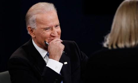 Vice President Joe Biden tries to stifle a laugh during Thursday's debate. It wasn't the only time.
