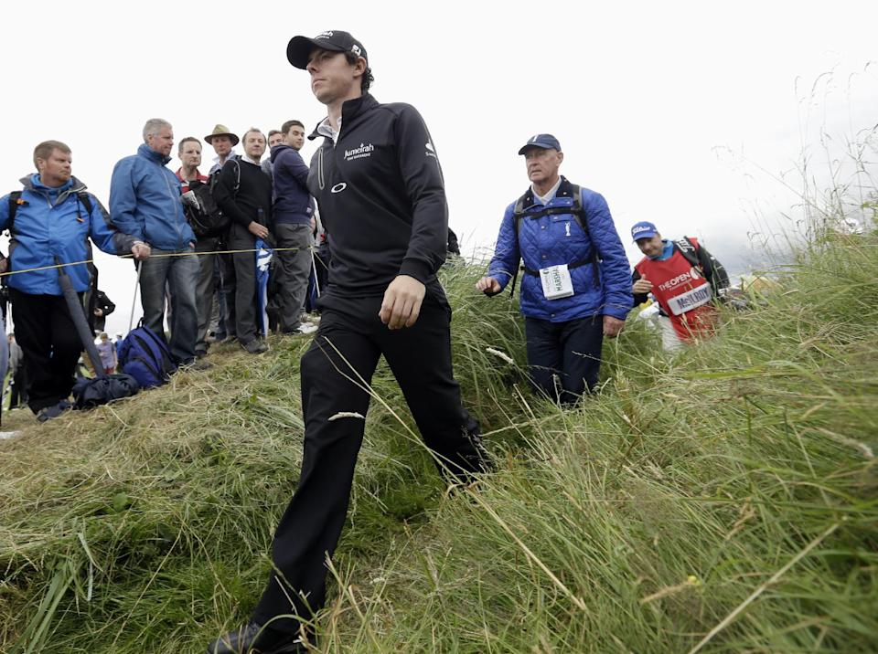 Rory McIlroy of Northern Ireland walks away after playing the 13th hole at Royal Lytham & St Annes golf club during the first round of the British Open Golf Championship, Lytham St Annes, England, Thursday, July 19, 2012. (AP Photo/Jon Super)