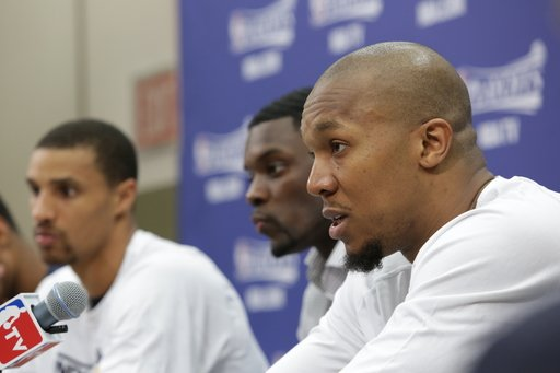 INDIANAPOLIS, IN - MAY 18:  David West #21 of the Indiana Pacers and teammates speak during a press conference after winning during Game Six of the Eastern Conference Semifinals between the New York K