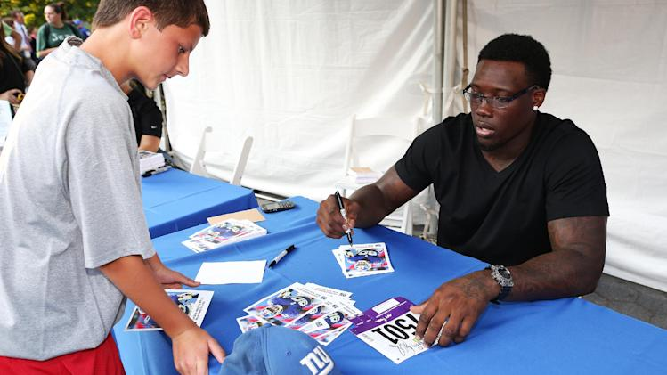 NFL defensive end Jason Pierre Paul is seen during the National Football League Back to Football Run on Friday, Aug. 30, 2012 at Central Park in New York. (John Minchillo/AP Images for NFL)