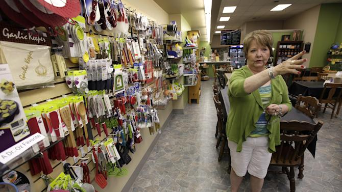 "In this Tuesday, June 19, 2012 photo, Alice Simons talks about the many items she has on display in one of her three stores in Carroll, Iowa. Mitt Romney's private sector resume has impressed Simons. ""I do think he has a little more business sense than Obama does,"" she says. ""The one thing that really bugs me is people criticize Romney for having money. ... I just want to see successful people. ... I guess what I'm saying if they have made their money in private business, why wouldn't we want somebody that has that sense and know-how?"" (AP Photo/Charlie Neibergall)"