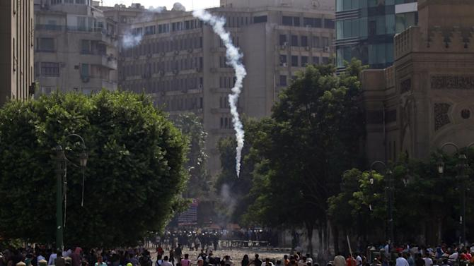 Egyptian police fire tear gas at protesters during clashes near the U.S. embassy in Cairo, Egypt, Thursday, Sept. 13, 2012. Protesters clashed with police near the U.S. Embassy in Cairo for the third day in a row. Egypt's Islamist President Mohammed Morsi vowed to protect foreign embassies in Cairo, where police were using tear gas to disperse protesters at the U.S. mission. (AP Photo/Khalil Hamra)