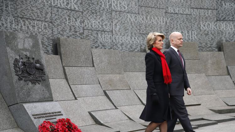 Britain's Foreign Secretary Hague and Australia's Foreign Minister Bishop walk away after laying wreaths during a ceremony marking the centenary of the start of World War One, at the Australian War Memorial in London
