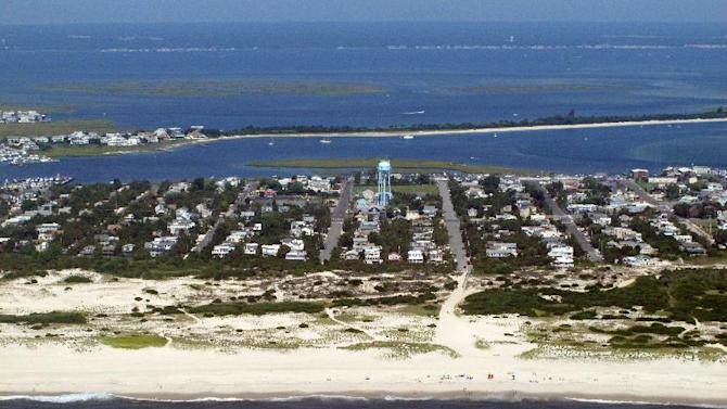 This July 11, 2014 aerial photo shows the coast of Barnegat Light, N.J., near where a plan to carry out seismic research on the ocean floor is being challenged by environmental and fishing groups. A federal appeals court on July 14, 2014 rejected New Jersey's effort to block the research, which will use loud sound waves to study the ocean floor as part of a climate change project. (AP Photo/Wayne Parry)