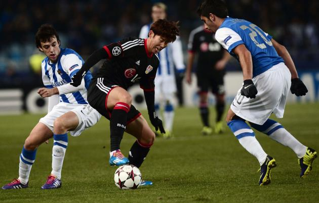 Real Sociedad's Jose Angel and Ruben Pardo challenge Bayer Leverkusen's Son Heung-min during their Champions League soccer match at Anoeta stadium in San Sebastian