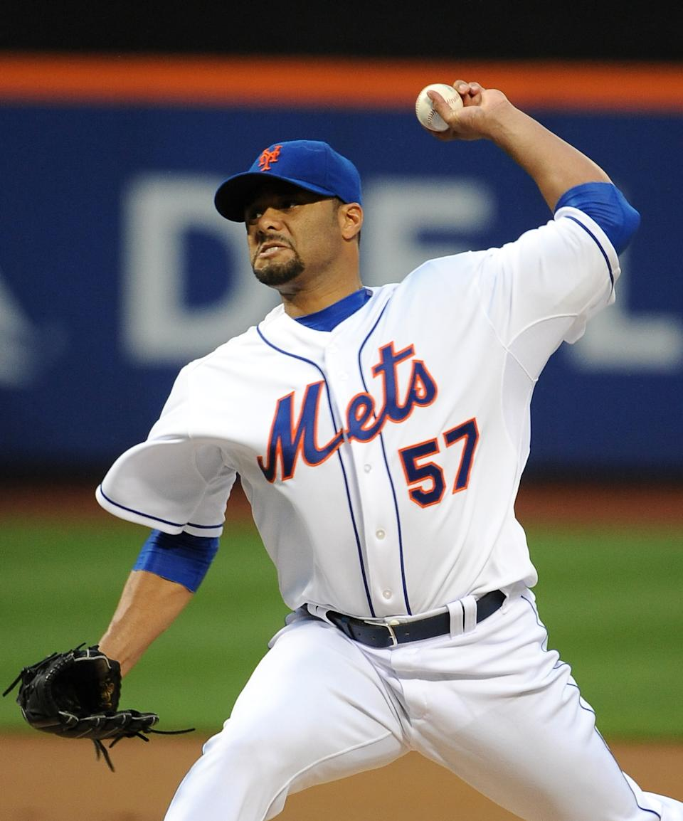 New York Mets starting pitcher Johan Santana (57) throws against the Los Angeles Dodgers in the first inning of a baseball game on Friday, July 20, 2012, at Citi Field in New York. (AP Photo/Kathy Kmonicek)