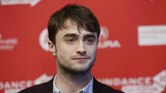 "Actor Daniel Radcliffe poses at the premiere of ""Kill Your Darlings"" during the 2013 Sundance Film Festival on Friday, Jan. 18, 2013 in Park City, Utah. (Photo by Danny Moloshok/Invision/AP)"