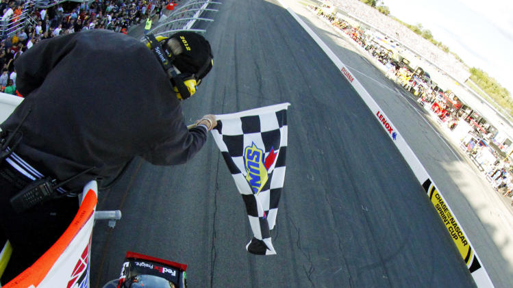 Denny Hamlin crosses the finish line to win the NASCAR Sprint Cup Series auto race at New Hampshire Motor Speedway, Sunday, Sept. 23, 2012, in Loudon, N.H. (AP Photo/Brian Lawdermilk, Pool)