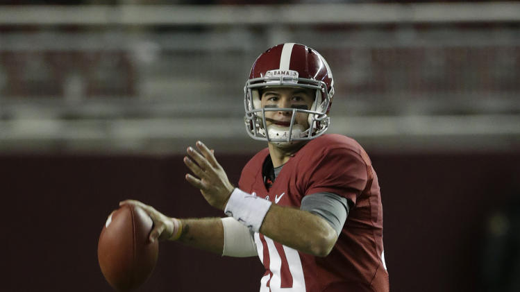Alabama quarterback AJ McCarron (10) looks for a receiver during the second half of an NCAA college football game against Mississippi State at Bryant-Denny Stadium in Tuscaloosa, Ala., Saturday, Oct. 27, 2012. (AP Photo/Dave Martin)