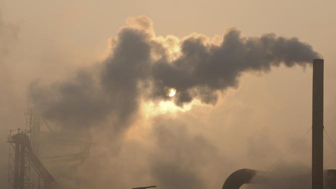 Smoke is emitted from chimneys of a cement plant in Binzhou city, in eastern China's Shandong province on Thursday, Jan. 17, 2013. China, the world's largest producer of carbon dioxide, is directly feeling the man-made heat of global warming, scientists conclude in the first study to link the burning of fossil fuels to one country's rise in its daily temperature spikes. The study appeared online in late March 2013 in the peer reviewed journal Geophysical Research Letters. (AP Photo)  CHINA OUT