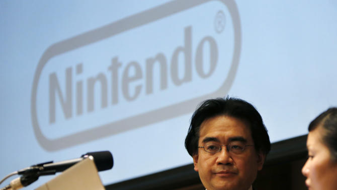 In this Thursday, Jan. 31, 2013 photo, Nintendo Co. President Satoru Iwata gets ready to speak during a news conference in Tokyo. As the yen weakens, famous Japanese exporters from Toyota to Nintendo are getting a boost but the favorable exchange rate also carries risks by insulating some companies from pressure to overhaul their businesses. Nintendo Co. raised its annual profit forecast through March 2013, to 14 billion yen ($154 million) from 6 billion yen ($66 million), largely because of the weak yen. (AP Photo/Koji Sasahara)