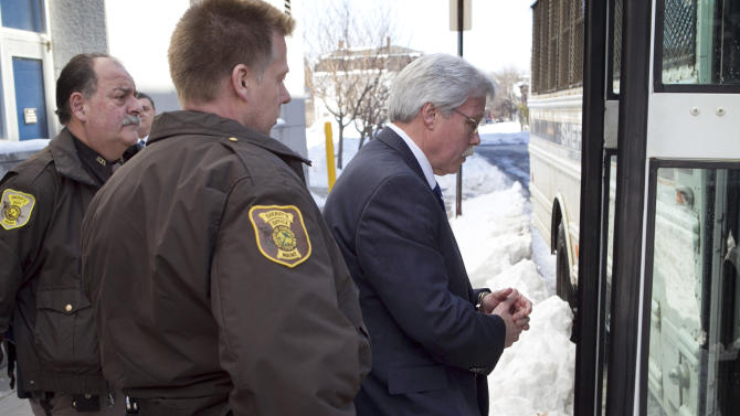 Mark Strong, Sr., leaves the Cumberland County Counthouse and is taken to jail after receiving a 20-day sentence and a $3,000 fine for his role in the Zumba prostitution case, Thursday, March 21, 2013, in Portland, Maine. Strong, an insurance agent, helped run a prostitution operation out of his mistress's Zumba studio in Kennebunk, Maine. (AP Photo/Robert F. Bukaty)