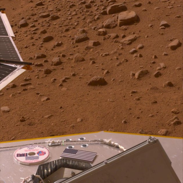 "This image provided by NASA shows a 2008 photo of a mini-DVD on the deck of the Phoenix lander on the Mars surface containing author Ray Bradbury's ""The Martian Chronicles"" and other science fiction w"