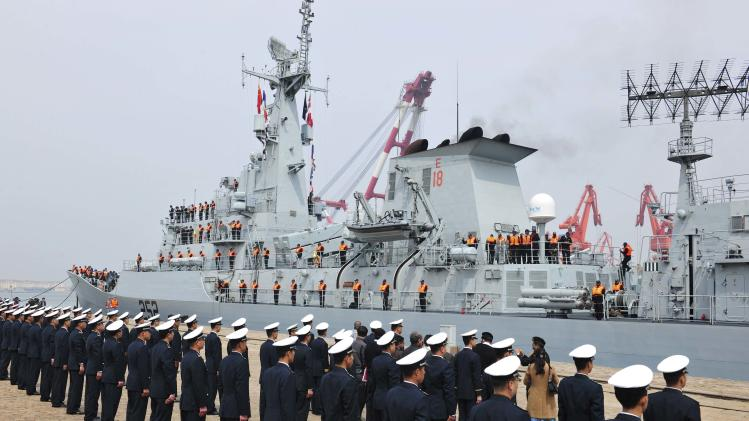 Chinese navy officers stand in formation as Pakistan naval frigate Shamsher arrives at a military port before a maritime drill during the Western Pacific Naval Symposium in Qingdao