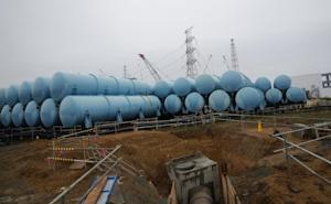 FILE - This Nov. 12, 2014 file photo shows water tanks…